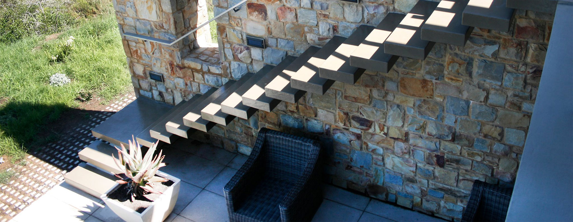 Floating staircase build into Stonework wall
